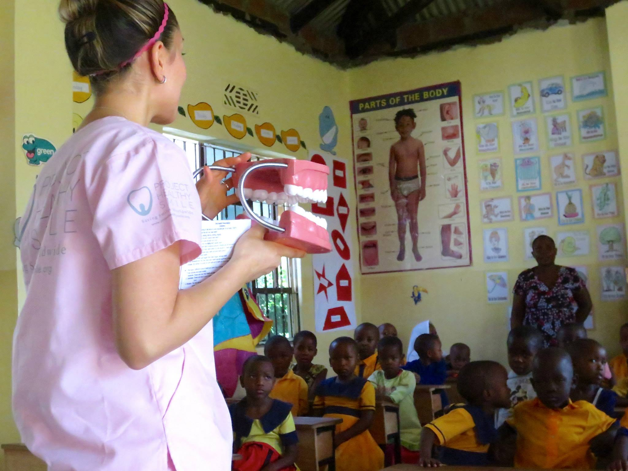 Michelle providing oral health education to the children of TAFCOM. Tooth model shown was donated to the staff.
