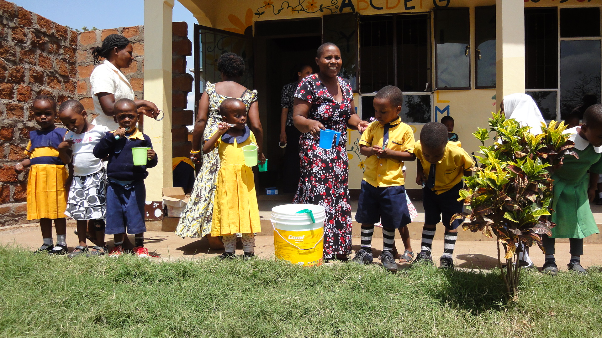 TAFCOM children brushing and rinsing at the school.