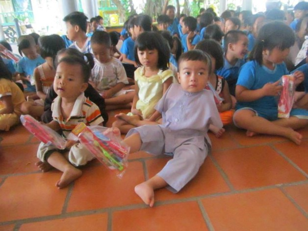 Children holding supplies
